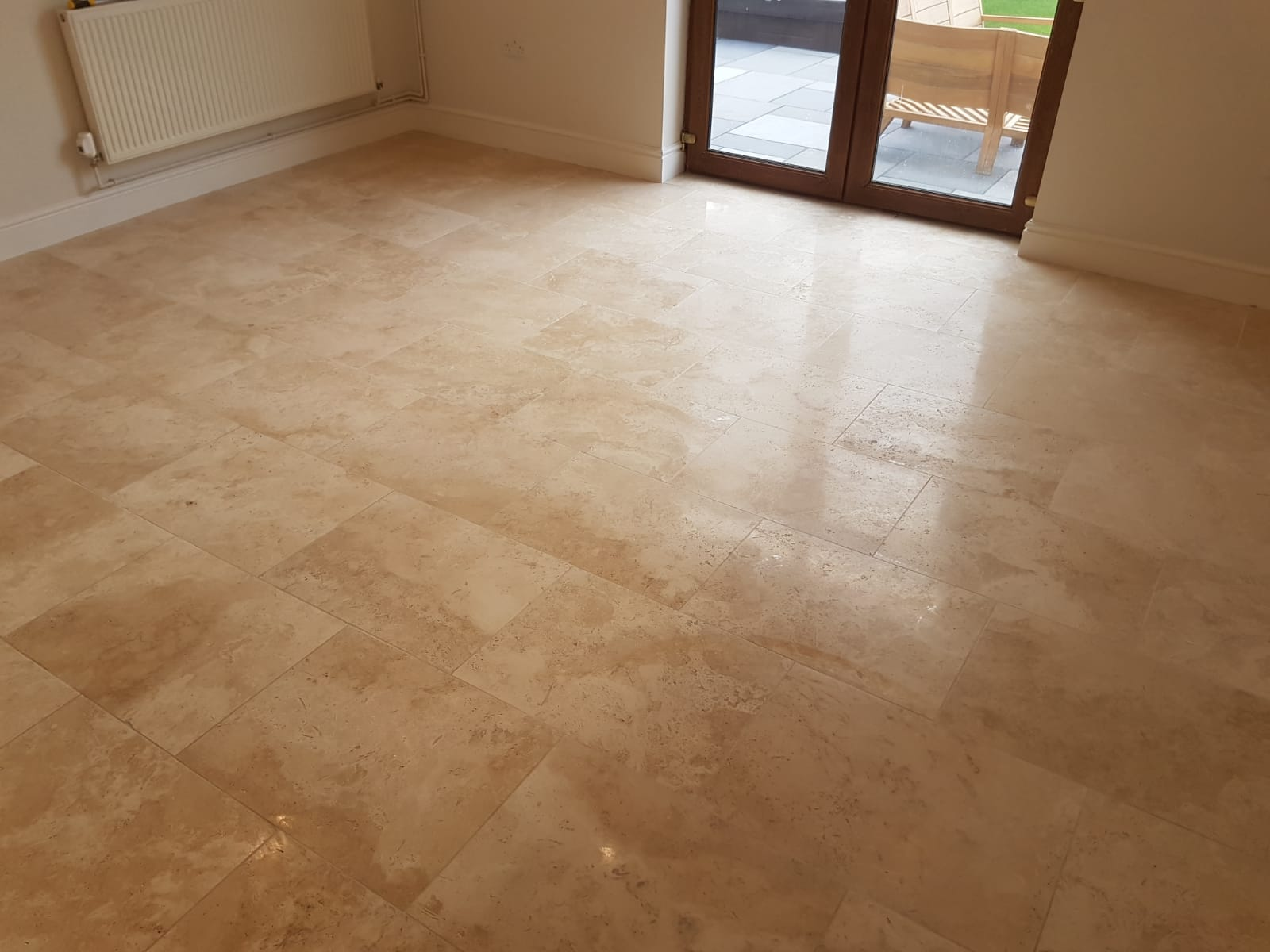 Travertine Floor with Lippage Issues After Milling in Gower Swansea