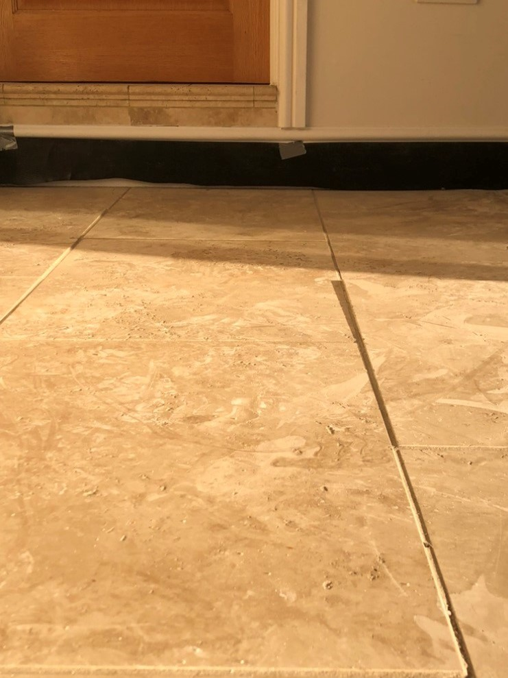 Travertine Floor with Lippage Issues Before Milling in Gower Swansea